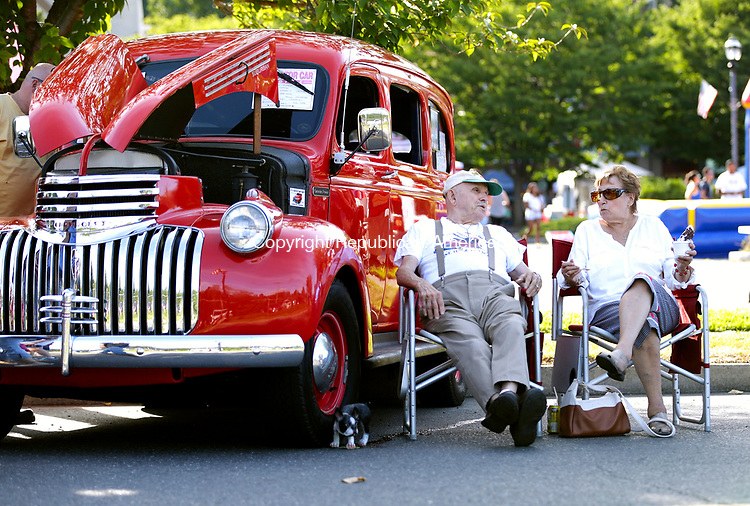 Naugatuck, CT- 13 August 2017-081317CM07-   Ed Brouillet and his wife Sally chat next to their 1941 Chevy Suburban7in downtown Naugatuck on Sunday. The town held a summer festival and car show.  The event featured food, crafts, vendors, games, and inflatable obstacle courses.  The night ended with a fireworks display.    Christopher Massa Republican-American