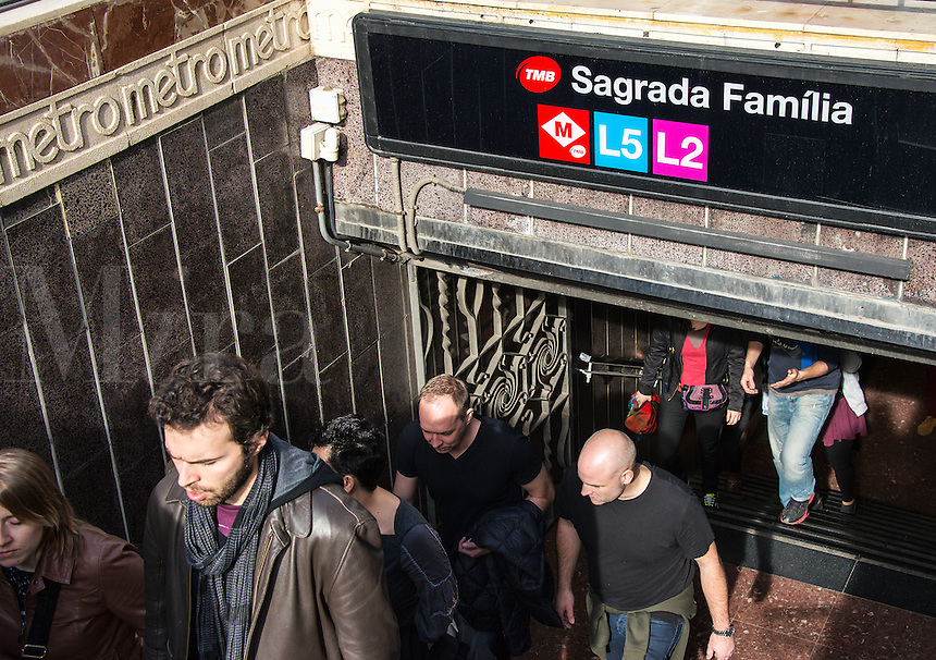 Busy metro stop and the Sagrada Familia, Barcelona, Spain