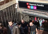Busy metro stop and the Sagrada Familia, Barcelona, Spain