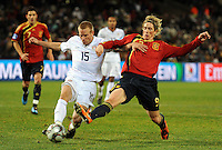 Fernando Torres of Spain and Jay DeMerit of USA. USA defeated Spain 2-0 during the semi-finals of the FIFA Confederations Cup at Free State Stadium in Manguang/Bloemfontein, South Africa on June 24, 2009..