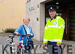 Seeing Red<br /> ------------------<br /> Since August 1st this year, cyclist who go through a red traffic light,cycle on the footpath or don't light up at night face a 40 euro on the spot fine,so be careful on your bike. Garda Martin Tierney pictured outside Castleisland Garda station last Wednesday morning with Josephine O'Reidy from Tullig