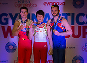 21st March 2018, Arena Birmingham, Birmingham, England; Gymnastics World Cup, day one, mens competition; Shogo Nonomura (JPN) on the podium after receiving his Gold medal with Silver medalist Nikita Nagornyy (RUS) and Bronze medalist James Hall (GBR)
