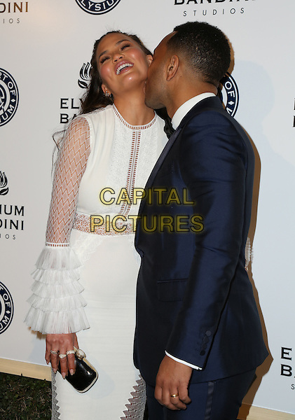 LOS ANGELES, CA - JANUARY 7: Chrissy Teigen and John Legend at the The Art Of Elysium Tenth Annual Celebration 'Heaven' Charity Gala at Red Studios i Los Angeles, California on January 7, 2017. <br /> CAP/MPI/PA<br /> &copy;PA/MPI/Capital Pictures