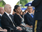 President Barack Obama and First Lady Michelle Obama look on as a flag is presented to Daniel Ken Inouye, Jr, son of the late U.S. Senator Daniel Inouye (Democrat of Hawaii) near the casket of the late Senator at the National Memorial Cemetery of the Pacific during funeral ceremonies on Sunday, December 23, 2012 . Senator Inouye was a Medal of Honor recipient and a U.S. Senator since 1963.    .Credit: Cory Lum / Pool via CNP