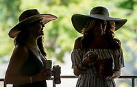 SARATOGA SPRINGS, NY - AUGUST 25: Two women hide from the sun on Travers Stakes Day at Saratoga Race Course on August 25, 2018 in Saratoga Springs, New York. (Photo by Scott Serio/Eclipse Sportswire/Getty Images)