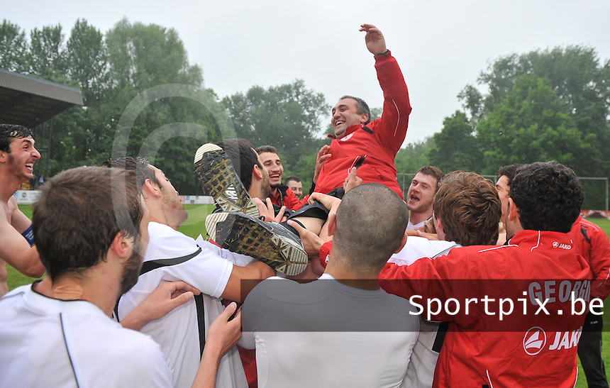 Georgia U19 - Belgium U19 : The Georgian team is celebrating their win over Belgium and their first place in group 6 and throwing their coach Giorgi Tsetsadze in the air<br /> foto DAVID CATRY / Nikonpro.be