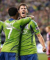 Seattle Sounders FC forward Brad Evans and defender James Riley celebrate after Evans scored on a penalty shot during play against Toronto FC at Qwest Field in Seattle Saturday April 30, 2011. The Sounders won the game 3-0.