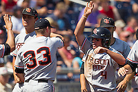 Oregon State outfielder Max Gordon (4) celebrates with teammate Ryan Barnes (33) after scoring in the sixth inning of Game 11 at the 2013 Men's College World Series against the Mississippi State Bulldogs on June 21, 2013 at TD Ameritrade Park in Omaha, Nebraska. The Bulldogs defeated the Beavers 4-1, to reach the CWS Final and eliminating Oregon State from the tournament. (Andrew Woolley/Four Seam Images)