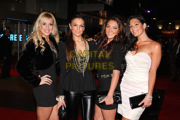 CANDY ROCK - Tita, Emily & Katerina & Sophia.attending the European Premiere of 'Harry Brown' at the Odeon Leicester Square, London, England, UK,.November 10th 2009..half length girl group band black hand on hip strapless white dress shoulder pads jacket necklace chains silver clutch bag fur cropped .CAP/ROS.©Steve Ross/Capital Pictures.