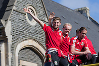 Ben Davies, Jonny Williams and Danny Ward during the open top bus Homecoming of the Wales Euro 2016 Squad in Cardiff City Centre, Cardiff,  on 8 July 2016. Photo by Mark  Hawkins / PRiME Media Images.