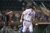 Scottsdale Scorpions left fielder Kevin Kaczmarski (17), of the New York Mets organization, takes his base after being hit by a pitch during an Arizona Fall League game against the Mesa Solar Sox on October 23, 2017 at Scottsdale Stadium in Scottsdale, Arizona. The Solar Sox defeated the Scorpions 5-2. (Zachary Lucy/Four Seam Images)