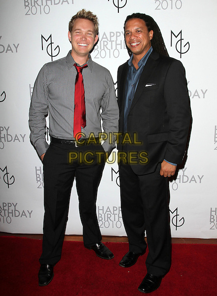 DAX HOLT, CHARLES LATIBEAUDIERE .at the Matt Goss Surprise Birthday Party held at A Private Location, Hollywood, CA, USA, 28th September 2010..full length grey gray shirt red tie black suit hands in pockets .CAP/ADM/FS.©Faye Sadou/AdMedia/Capital Pictures.
