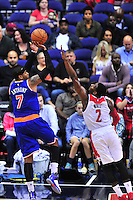 Carmelo Anthony of the Knicks shoots against Wizards John Wall. New York defeated Washington 115-104 during a NBA preseason game at the Verizon Center in Washington, D.C. on Friday, October 9, 2015.  Alan P. Santos/DC Sports Box