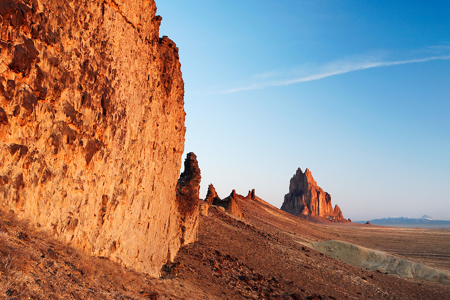 Shiprock Rock and face of dike ridge at sunrise, New Mexico, USA