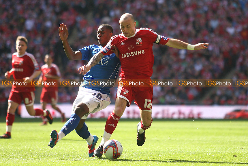 Franck Moussa and Alan McCormack of Swindon Town -  Chesterfield vs Swindon Town - at the Wembley National Stadium - 25/03/12 - MANDATORY CREDIT: Dave Simpson/TGSPHOTO - Self billing applies where appropriate - 0845 094 6026 - contact@tgsphoto.co.uk - NO UNPAID USE.