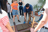 "Occidental College's 2016-2017 Wanlass Artist in Residence, Rafa Esparza, works with students, in combination with professor Mary Beth Heffernan's class, to make adobe bricks on Weingart patio on Sept. 6, 2016.<br /> The Wanlass Artist-in-Residence is Oxy's semester-long residency program that allows an artist to investigate aspects of their practice and share it with the College campus-wide. The program encourages cross-campus collaboration and thoughtful sustained interaction between artist and students. The Wanlass Artist in Residence Program is made possible by generous support from the Kathryn Caine Wanlass Charitable Foundation. Esparza's class is called ""Manos de Obra: Bodies Making Los Angeles,"" an experimental interdisciplinary studio class.<br /> (Photo by Marc Campos, Occidental College Photographer)"