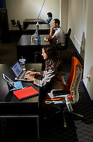 Business photography of Packard Place tenants Lenore Vassil, president of The Torch, and Flaviu Simihaian, (middle) co-founder of Flavma Inc, in their office space inside of Packard Place.  Located in the heart of uptown Charlotte, NC, Packard Place is a hub for entrepreneurship and innovation, helping to grow business startups in the community.