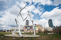 The Dancers sculpture by Jonathan Borofsky, in Downtown Denver, Colorado, Saturday, April 18, 2015. The sculpture consists of two 50-foot high sculptures located at Speer and Champa streets.<br /> <br /> Photo by Matt Nager