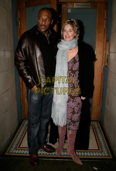 COLIN SALMON & WIFE.Grand Classics - Annie Hall - private VIP screening at the Electric Cinema Cinema, London, UK..December 12th, 2005.Ref: Ah.full length black leather jacket husband married blue scarf.www.capitalpictures.com.sales@capitalpictures.com.©Capital Pictures
