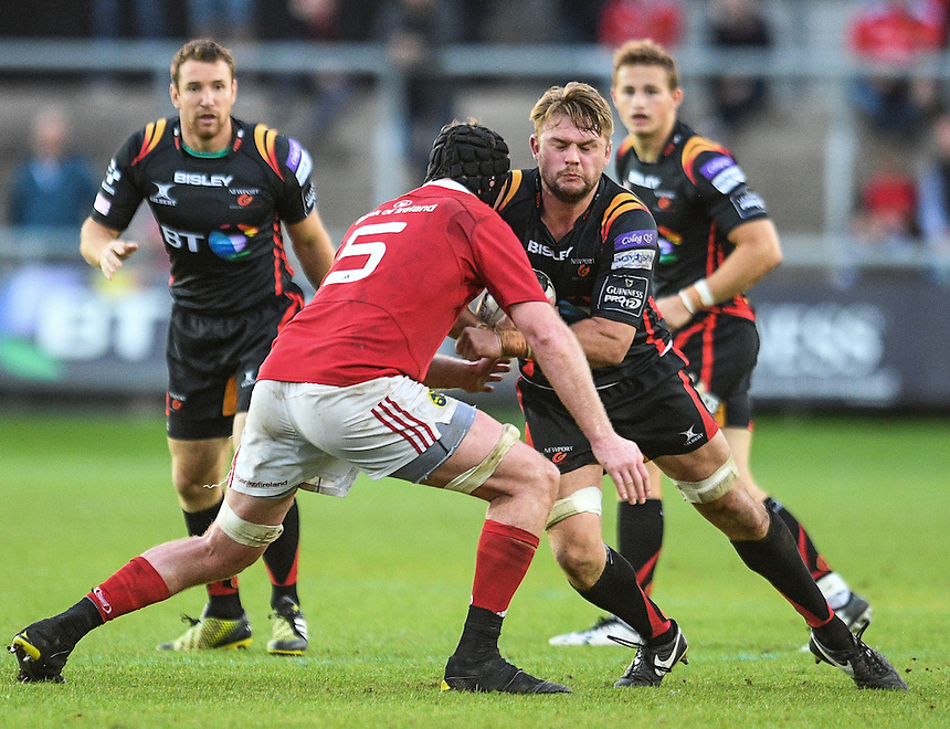 Lewis Evans of Dragons is tackled by Donnacha Ryan of Munster<br /> <br /> Photographer Craig Thomas/CameraSport<br /> <br /> Guinness PRO12 Round 3 - Newport Gwent Dragons v Munster Rugby - Saturday 17 September 2016 - Rodney Parade - Newport<br /> <br /> World Copyright &copy; 2016 CameraSport. All rights reserved. 43 Linden Ave. Countesthorpe. Leicester. England. LE8 5PG - Tel: +44 (0) 116 277 4147 - admin@camerasport.com - www.camerasport.com