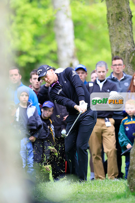 Danny Willett (ENG) in the trees for his 2nd shot on the 2nd hole during Saturday's Round 3 of the 2016 Dubai Duty Free Irish Open hosted by Rory Foundation held at the K Club, Straffan, Co.Kildare, Ireland. 21st May 2016.<br /> Picture: Eoin Clarke | Golffile<br /> <br /> <br /> All photos usage must carry mandatory copyright credit (&copy; Golffile | Eoin Clarke)