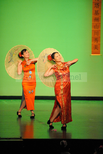 Two women perform a traditional Chinese dance.