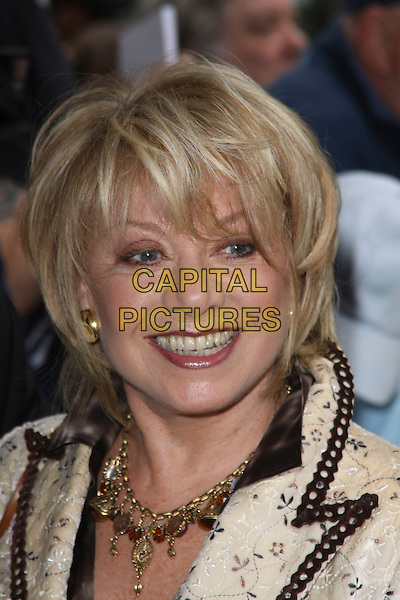 ELAINE PAIGE .Attending the 55th Ivor Novello Awards held at Grosvenor House Hotel in London, England, UK,  May 20th, 2010..arrivals portrait headshot smiling make-up gold necklace black cream yellow .CAP/AH.©Adam Houghton/Capital Pictures.