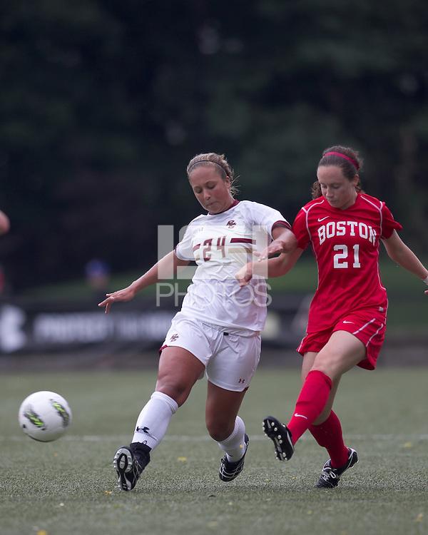 Boston University midfielder Megan McGoldrick (21) passes the ball as Boston College forward/midfielder Rachel Davitt (24) defends. After 2 complete overtime periods, Boston College tied Boston University, 1-1, after 2 overtime periods at Newton Soccer Field, August 19, 2011.