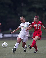 Boston University midfielder Megan McGoldrick (21) passes the ball as Boston College forward/midfielder Rachel Davitt (24) defends. After 2 complete overtime periods, Boston College tied Boston University, 1-1, after 2 overtime periods at Newton Soccer Field, August 19, 2011.