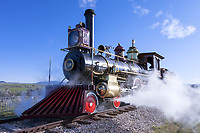 The Union Pacific Railroad's locomotive No. 119 belches steam as it makes its way into position for the ceremonies celebrating the 150th anniversary of the completion of the Transcontinental Railroad and the driving of the golden spike on the morning of May 10, 2019.