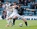 Dundee's Paul McGowan holds off Caley's Graeme Shinnie.