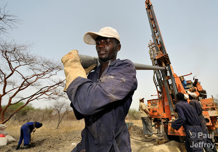 Workers drill for water as part of a Catholic Church-sponsored project to bring life back to Marail Achak, a village in the disputed Abyei region on the border between Sudan and South Sudan. The families living here fled south in 2011 after an attack by soldiers and militias from the northern Republic of Sudan on most parts of Abyei. Although the 2005 Comprehensive Peace Agreement called for residents of Abyei to hold a referendum on whether they wanted to align with the north or the newly independent South Sudan, the government in Khartoum and northern-backed Misseriya nomads, excluded from voting as they only live part of the year in Abyei, blocked the vote and attacked the majority Dinka Ngok population. The African Union has proposed a new peace plan, including a referendum to be held in October 2013, but it has been rejected by the Misseriya and Khartoum. The Catholic parish of Abyei, with support from Caritas South Sudan and other international church partners, has maintained its pastoral presence among the displaced and assisted them with food, shelter, and other relief supplies. In Marail Achak, where residents have begun to return despite the absence of U.N. troop patrols or other international support, the church paid for this well to be drilled so returnees could have safe drinking water for themselves and their animals. The wells they had used in years past were destroyed by the northerners before they withdrew.