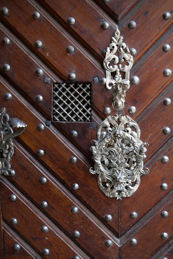 Ornate metal and wooden door in Prague, Czech Republic, Europe