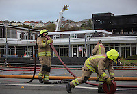 Pictured: Fire fighters at the scene of a large fire at the Gower College Swansea in the Tycoch area of Swansea, Wales, UK. Friday 28 October 2016<br />Re: About 100 firefighters have been tackling a large fire at Gower College Swansea.<br />Mid and West Wales Fire Service was called to Gower College on Tycoch Road, Sketty, just before 4:30am on Friday.<br />It said the fire covered the second and third floors of a four-storey building but it is now under control.<br />There were about 20 fire appliances at the scene, the incident is ongoing and Tycoch Road is shut.