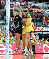 13.10.2013 Silver Fern Cathrine Latu and Australian Diamond Laura Geitz and Bianca Chatfield in action during the Silver Ferns V Australian Diamonds Netball Series played at the AIS Arena in Canberra Australia. Mandatory Photo Credit ©Michael Bradley.