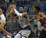 Nevada forward Jordan Brown (21) looks to pass the ball against Little Rock in the second half of an NCAA college basketball game in Reno, Nev., Friday, Nov. 16, 2018. (AP Photo/Tom R. Smedes)