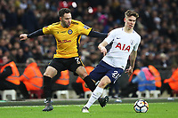 Juan Foyth of Tottenham Hotspur is challenged by Robbie Willmott of Newport County during the Fly Emirates FA Cup Fourth Round Replay match between Tottenham Hotspur and Newport County at Wembley Stadium, London, England, UK. 07 February 2018