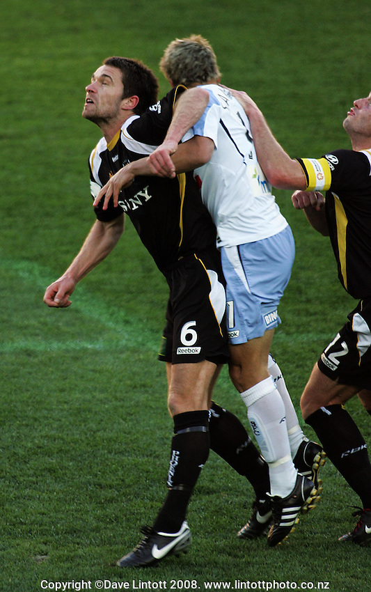 Tim Brown and Brendon Santalab collide, with Brown cutting his head during the A-League Round Six football match between Wellington Phoenix and Sydney FC at Westpac Stadium, Wellington, New Zealand on Sunday, 14 September 2008. Photo: Dave Lintott / lintottphoto.co.nz