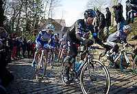 Sir Bradley Wiggins (GBR/Sky) over the cobbles of the infamous Muur van Geraardsbergen<br /> <br /> Omloop Het Nieuwsblad 2015