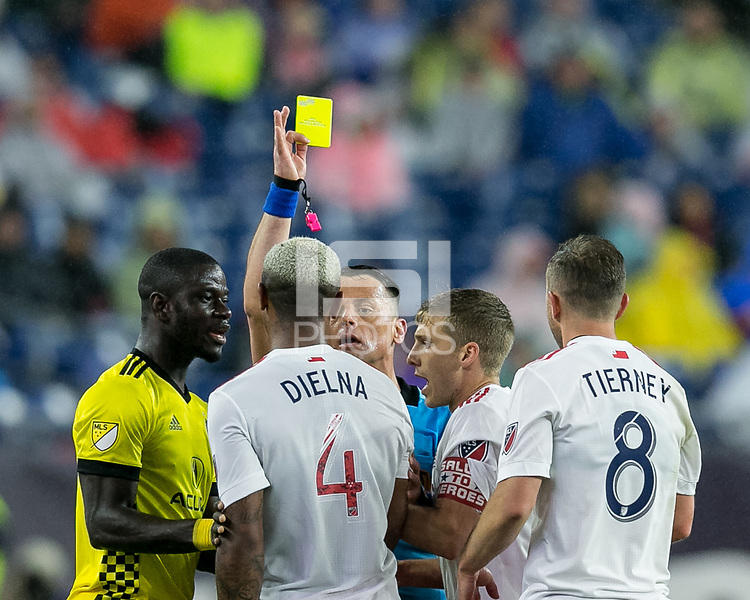Foxborough, Massachusetts - May 19, 2018:  In a Major League Soccer (MLS) match, Columbus Crew (yellow) defeated New England Revolution (white/red), 1-0, at Gillette Stadium.<br /> Yellow Card: Claude Dielna