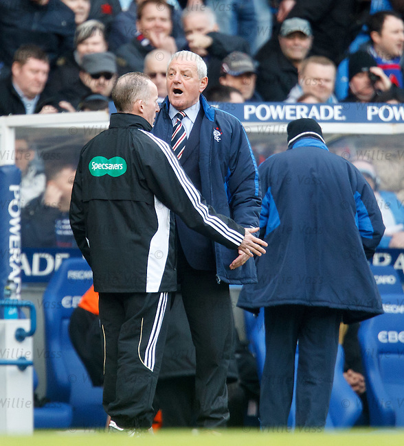 Walter Smith restrained by fourth official