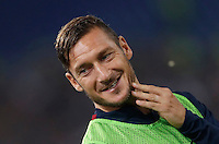 Calcio, Serie A: Roma vs Inter. Roma, stadio Olimpico, 2 ottobre 2016.<br /> Roma&rsquo;s Francesco Totti smiles as he warms up during the Italian Serie A football match between Roma and FC Inter at Rome's Olympic stadium, 2 October 2016.<br /> UPDATE IMAGES PRESS/Isabella Bonotto