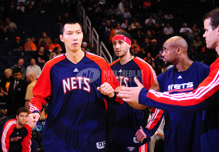 Jan. 20, 2010; Phoenix, AZ, USA; New Jersey Nets center (9) Yi Jianlian greets teammates prior to the game against the Phoenix Suns at the US Airways Center. The Suns defeated the Nets 118-94. Mandatory Credit: Mark J. Rebilas-
