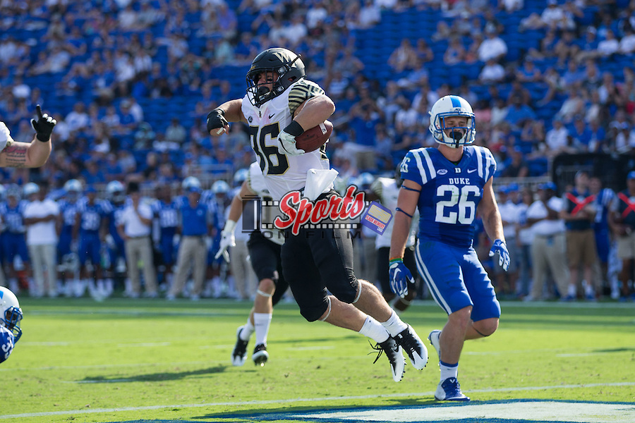 Cade Carney (36) of the Wake Forest Demon Deacons celebrates after scoring his first collegiate touchdown during first half action against the Duke Blue Devils at Wallace Wade Stadium on September 10, 2016 in Raleigh, North Carolina.  (Brian Westerholt/Sports On Film)