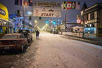 Iditarod Executive Director Stan Hooley surveys the start line in the early hours prior to the ceremonial start of the Iditarod sled dog race in downtown Anchorage Saturday, March 2, 2013. ..Photo (C) Jeff Schultz/IditarodPhotos.com  Do not reproduce without permission