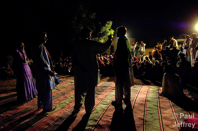 Activists present a play in a rural Pakistani village outside Mirpurkhas, focusing on relationships between men and women and between the landless poor and local feudal landlords. The play was presented by the Lower Sindh River Development Association, which works in southern Pakistan providing education, credit, and empowerment to vulnerable groups often living in virtual slavery to large landowners. At the end of the play, a dialogue with villagers takes place.