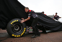 Apr. 27, 2013; Baytown, TX, USA: Tyler Boninfante , crew member for NHRA top fuel dragster driver Steve Torrence helps move the car back to the pits during a rain delay to qualifying for the Spring Nationals at Royal Purple Raceway. Mandatory Credit: Mark J. Rebilas-
