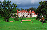 The Chateau des Vigiers in Bergerac near Bordeaux. Luxury hotel and restaurant with a golf course. Two golf players on the fairway to the 18th eighteenth green. Early 17th seventeenth century, Bordeaux Gironde Aquitaine France Europe