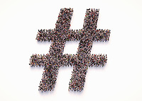 Overhead view of crowd of people forming hashtag symbol