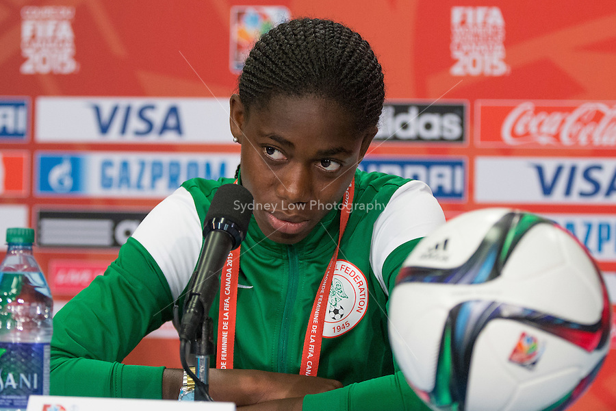June 15, 2015: Asisat OSHOALA of Nigeria at a press conference prior to a Group D match at the FIFA Women's World Cup Canada 2015 between Nigeria and the USA at BC Place Stadium on 16 June 2015 in Vancouver, Canada. Sydney Low/Asteriskimages.com
